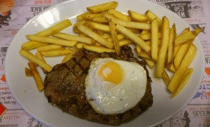 7oz rib-eye steak, with chips and fried egg.