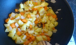 Soften the vegetables in oil